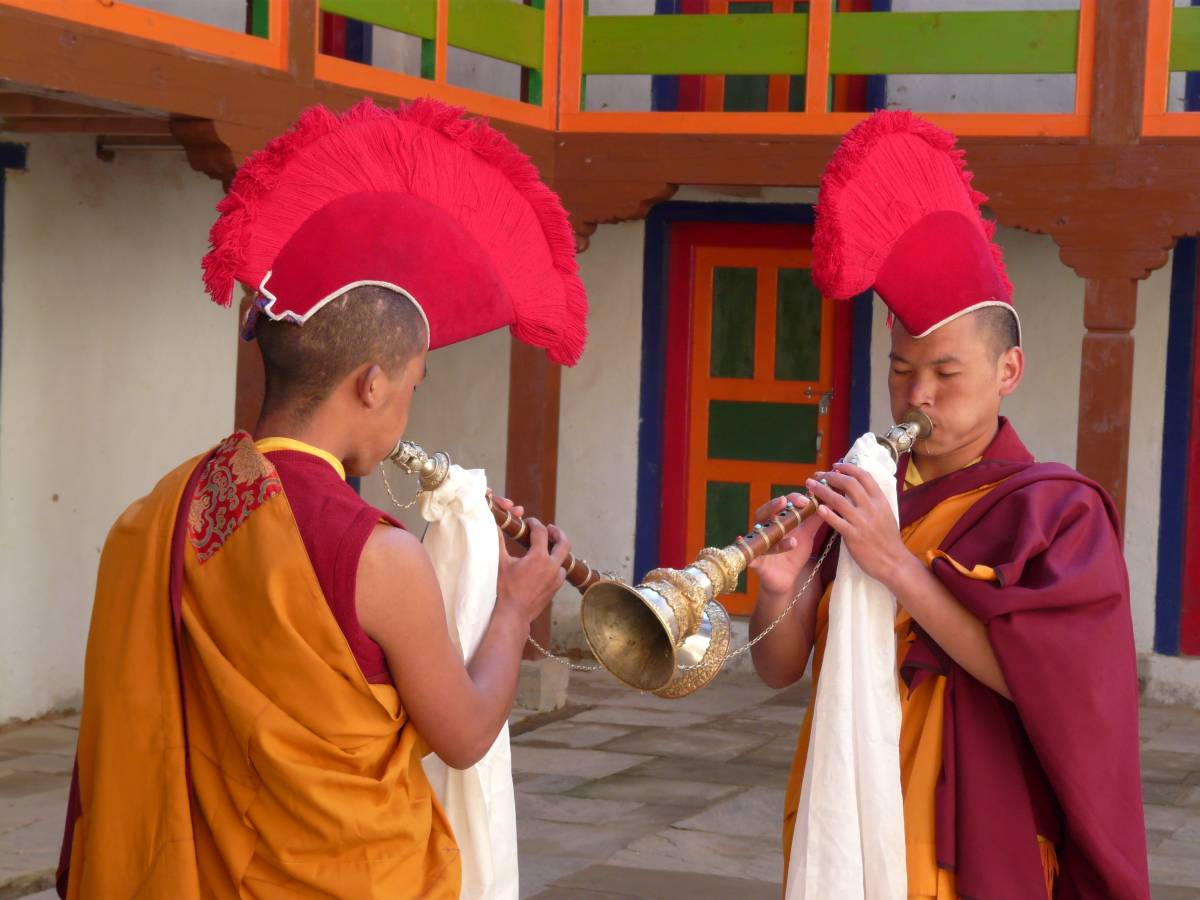 Monks playing the gyaling clarinets